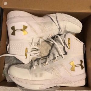 White and gold Under Armour volleyball shoes